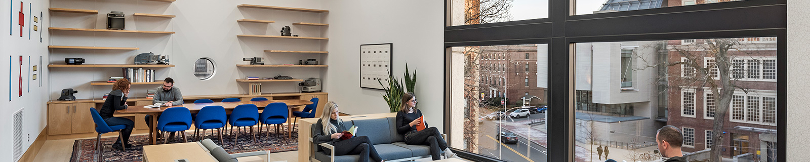 Living Room in 485 Broadway, students reading and conversing